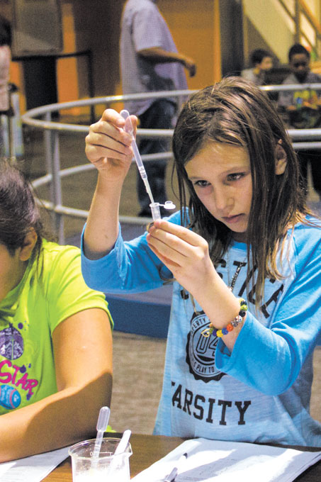A child participates in a DNA extraction activity during a CSI Science Overnight at Science Museum Oklahoma. (Science Museum Oklahoma / provided)
