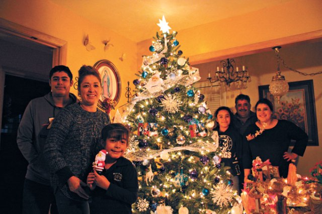 The Chavez family of south Oklahoma City spends Christmas Eve with members of their extended family for a traditional <em>Posada</em> celebration that includes re-enacting Mary and Joseph's journey to Bethlehem. (Laura Eastes)