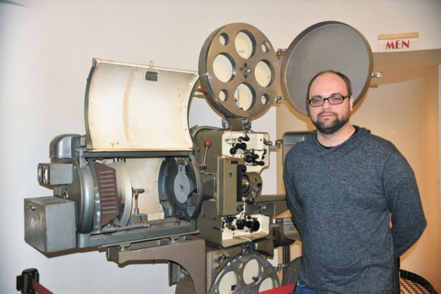 Tower Theatre operator Stephen Tyler shows the one of theater's original projector. (Jacob Threadgill)