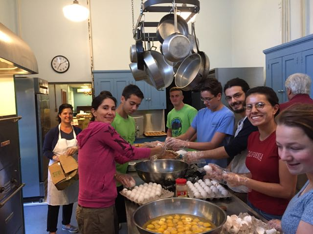 the volunteers from Morrisville Presbyterian crack some eggs!