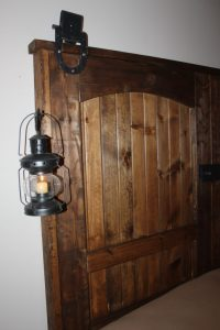 The doors with lanterns and reclaimed barn track pulleys attached