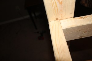 Close up of the rectangle shelf supports attached to the post. We attach 4 screw on the outside of each shelf angle support to add extra strength to each