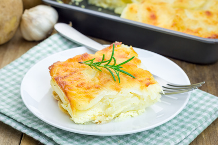 Potato gratin on a white plate