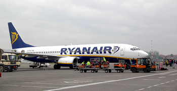 A Ryanair 737 loading luggage for a flight