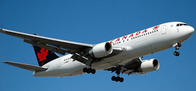 An Air Canada airplane flying in the sky