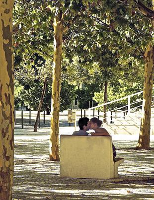 Couple kissing in Parque das Nações, Lisbon, Portugal