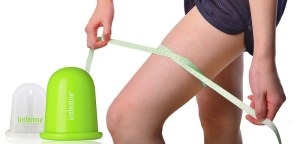 perfect womans legs measure by metre-stick over white