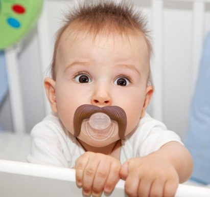 "Ferrari Press Agency Ref 5109 stachifier 1 01/02/2013 See Ferrari text  Picture crdit: Perpetualkid.com Things are looking hairy for babies – with a new range of pacifiers which appear to give them a moustache.  Called the Stachifier, they come in three different styles featuring a gentleman's handlebar whiskers, a droopy cowboy and a ladies man for the romancer.  The pacifiers  are being sold by US website perpetualkid.com for $10 USD / £6 GBP / €7 Euros .  A spokesman said:"" Do you want your baby to command the respect and admiration that they deserve?    ""With our Gentleman Stachifier, your baby will be the most refined, polished little one on the block!    ""Nothing says class like a well-groomed handlebar mustache pacifier and your baby will have one right under their nose to prove it!  ""Our Ladies Man Stachifier will take your baby from cute to irresistible.    ""There's no better choice than this classic, Tom Selleck inspired mustache pacifier.  ""Once your baby gets our Cowboy Stachifier in their mouth, the wild, wild west will come alive right before your eyes.""  As well as looking mart, it is also safe.  The orthodontic shape, snap-on hygienic cap with silicone teat is recommended for babies aged 6 months to 36 months.   OPS: Baby modelling the Cowboy Stachifier"
