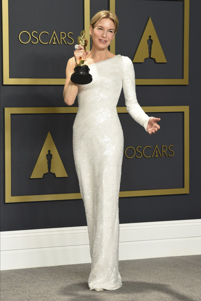 """Renee Zellweger, winner of the award for best performance by an actress in a leading role for """"Judy"""", poses in the press room at the Oscars on Sunday, Feb. 9, 2020, at the Dolby Theatre in Los Angeles. (Photo by Jordan Strauss/Invision/AP)"""