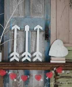Paint-stick-arrows-yarn-heart-handmade-mantle