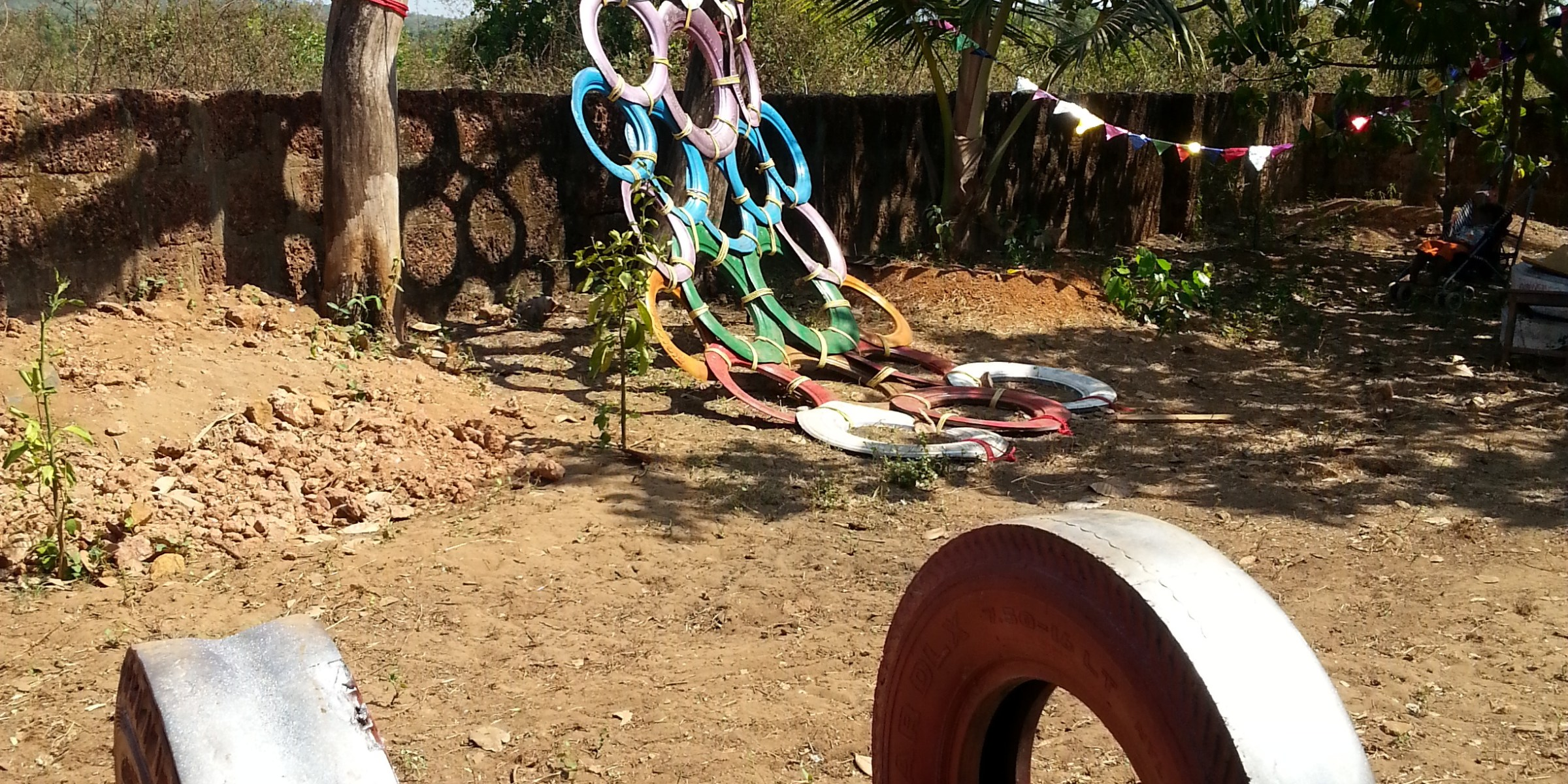 Diy tire climbing wall recycled materials onenomadwoman for Tire play structure