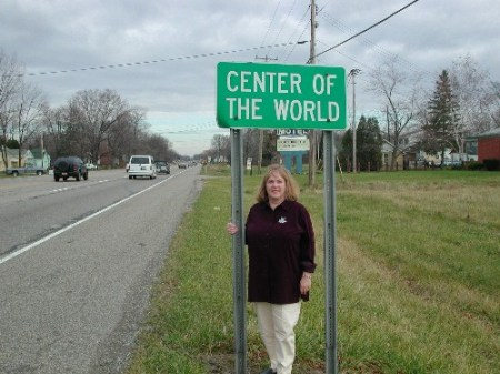 Bonnie Zurcher standing at the edge of the Center of the World, Ohio