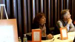 Regina Brett talking with fan at Buckeye Book Fair in Wooster 2010