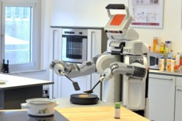 'PR2' flips a pancake in a laboratory kitchen at Bremen University