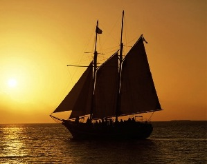 sailing at sea at sunset in schooner