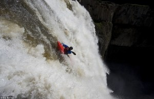 tyler bradt kayaking over waterfall on the horizon line