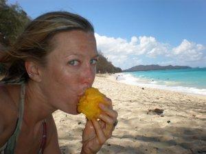 brianna randall eating a mango - on the horizon line sailing