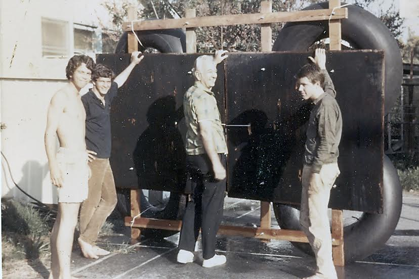 "Steve Randall, John Castle, Bob Randall, and Brian Pike showing off their ""raft"" before launching on the Colorado River."
