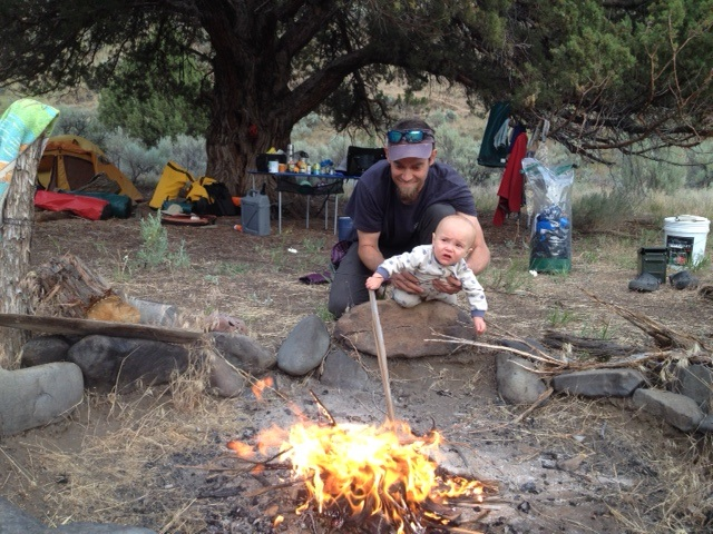 Someone is as obsessed with tending the fire as his daddy.