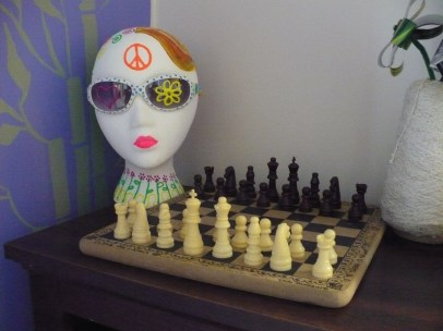 painted mannequin head with chess board