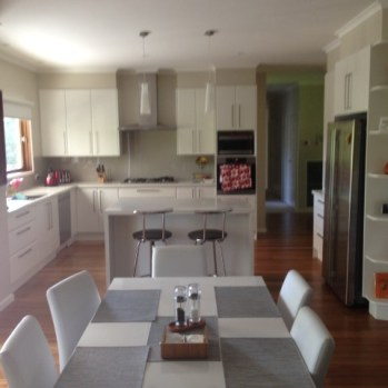 New kitchen installed in renovated area with spotted gum timber flooring with wax polish finish.