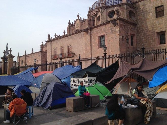 Normalista camp in front of cathedral.