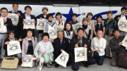 Adult delegation from Mombetsu arrives in Newport and receives gift bags