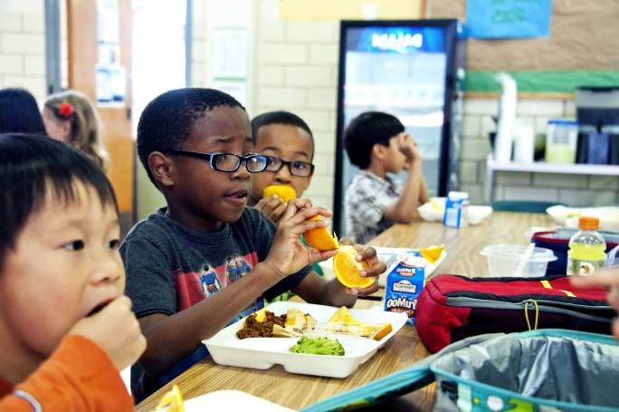 Young african american boy was photographed as he was eating a f