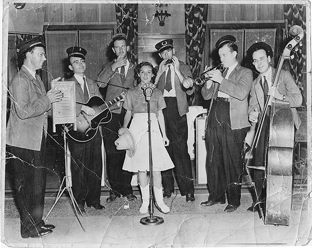 """""""Little Lorraine, the yodeling schoolgirl"""" on Fort Worth radio station WBAP with the """"Washboard Swingsters"""" (later known as the Crazy Gang)."""