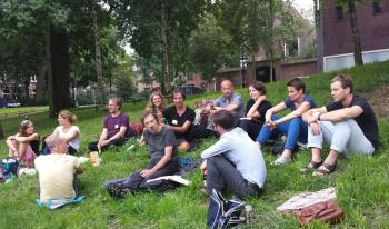 Socializing by the canal in Utrecht after the all-day singing.