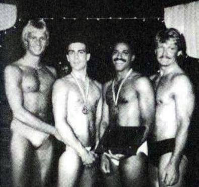 """""""We Are Family"""" - Masculine excellence gathers at the fourth annual Mr. Gay All-American Contest in July 1986 at the Old Plantation in Dallas, as the first three national titleholders welcome the newest member to their brotherhood. From left: MGAA 1985 Keith Mitchell; MGAA 1986 Ered Matthew; MGAA 1987 Medwin Johnson; and MGAA 1984 Ron East."""