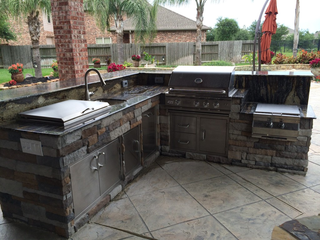 outdoor kitchens outdoor kitchen island Our projects in Houston include outdoor living space designs like this outdoor kitchen island with an