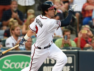 Aug 17, 2016; Atlanta, GA, USA;  Atlanta Braves shortstop Dansby Swanson (2) lines out during his first at bat in the majors against the Minnesota Twins during the second inning at Turner Field. Mandatory Credit: Dale Zanine-USA TODAY Sports