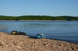 Two Ascend kayaks pulled onto the shore of Truman Lake, the occupants came ashore to explore.