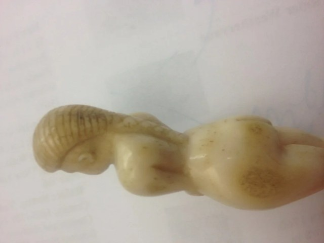7: Naive Carved Bone Figure in the Form of Female Nude