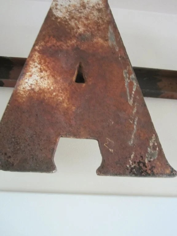 165: Painted Sheet Iron 'EAT' Sign
