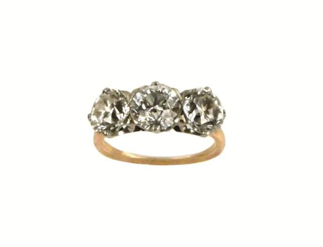 221:Platinum and  Gold Three Stone Diamond Ring