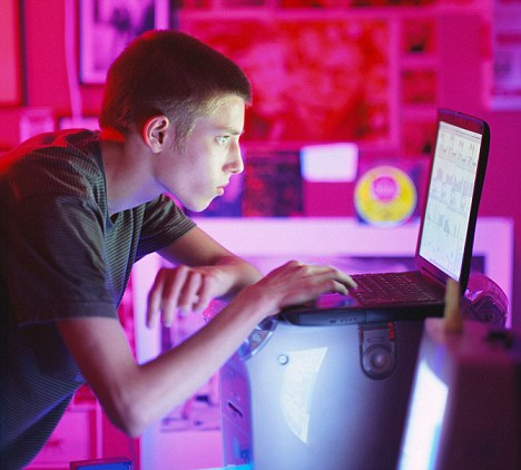 Teenager Using Laptop in Bedroom