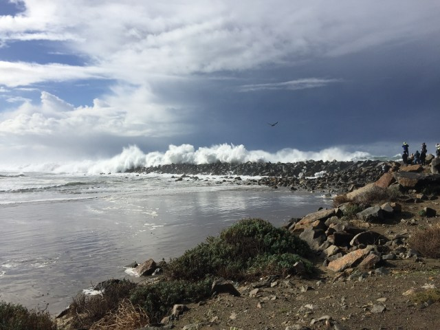 High surf breaking on the north jetty  Photo by Heather O'Connor