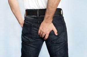 man grabs ass