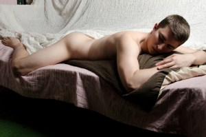 naked man on bed