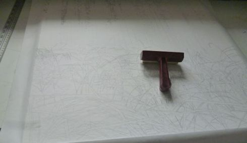 I started by making my drawing on the paper and then I mounted that paper on the board.