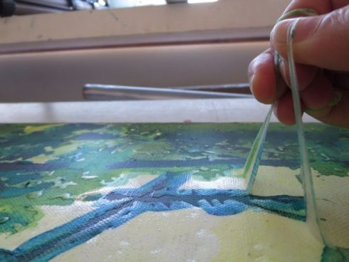 When everything has dried, I remove the masking fluid by delicately pulling on it. I make sure I didn't forget any area by passing my hand on the canvas, the masking fluid has a different texture that you can feel.