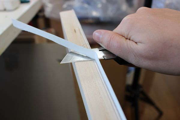 cutter to trim excess paper