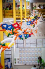 A colorful project hangs from the ceiling at Synapse. Photo credit: Synapse School