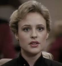 Pamela Winslow Kashani as Ensign McKnight in Star Trek: The Next Generation