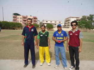 Finalist captains with umpires at beginning of the match