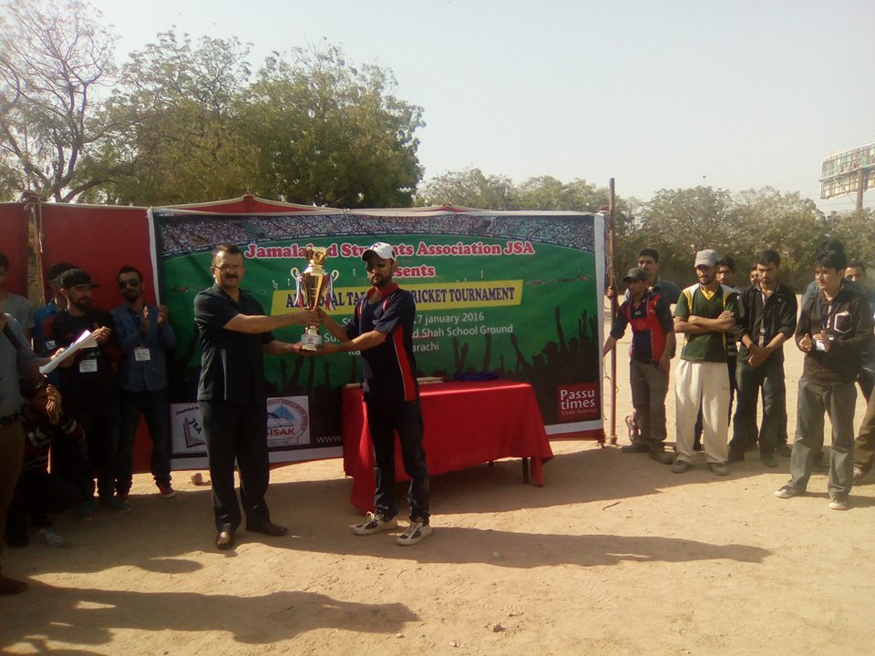 Hikmat, the winning captain, receiving the trophy