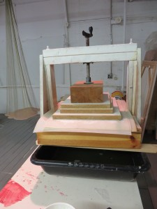 Pressing the sheets of leek paper