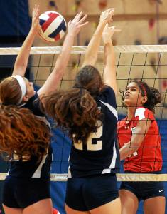 Bob Raines--Digital First Media Plymouth Whitemarsh's Taylor O'Brien tries to spike the ball past North Penn's Victoria Smith and Emily Beynon Sept. 21, 2016.